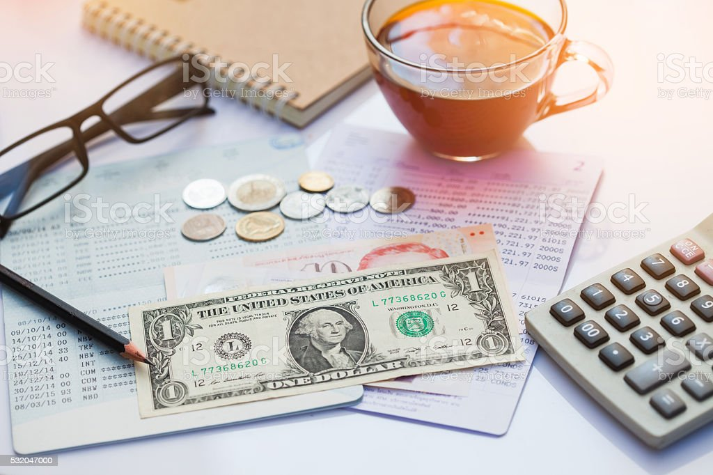 Bank account,dollar, cions and cup of tea. stock photo