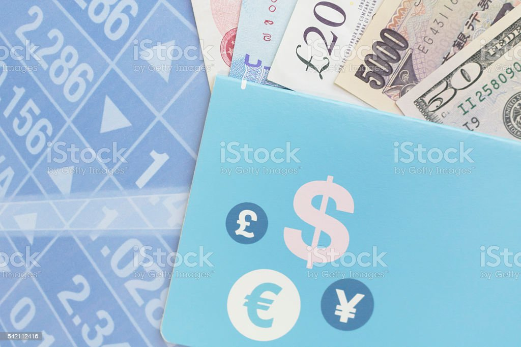 Bank book, money, and stock market graph stock photo