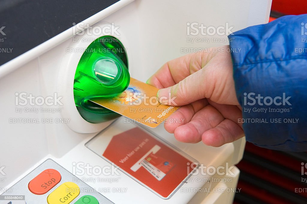 Bank card into ATM machine stock photo