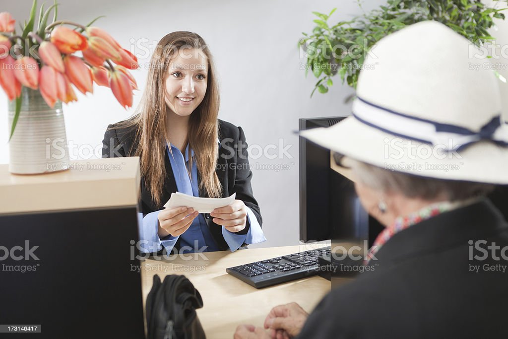 Bank Counter Window with Customer Making Transaction to Teller Hz royalty-free stock photo