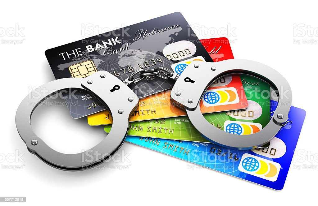 Bank credit cards and handcuffs isolated on white stock photo