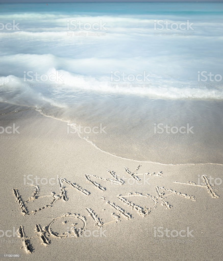 Bank holiday message in the sand royalty-free stock photo