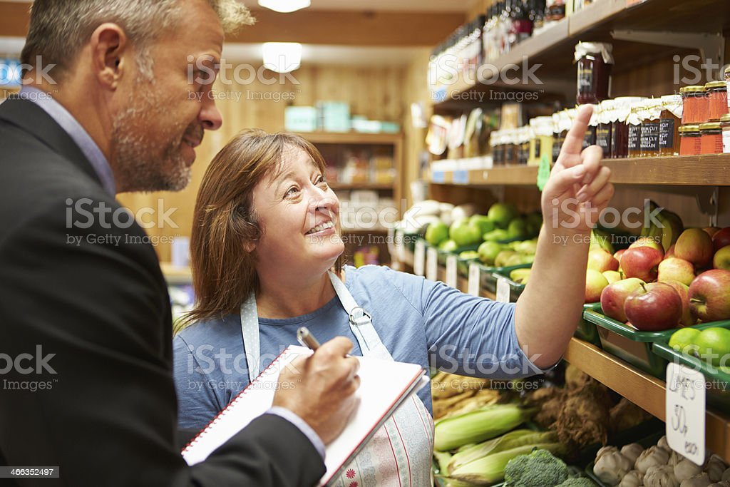Bank Manager Meeting With Female Owner Of Farm Shop stock photo