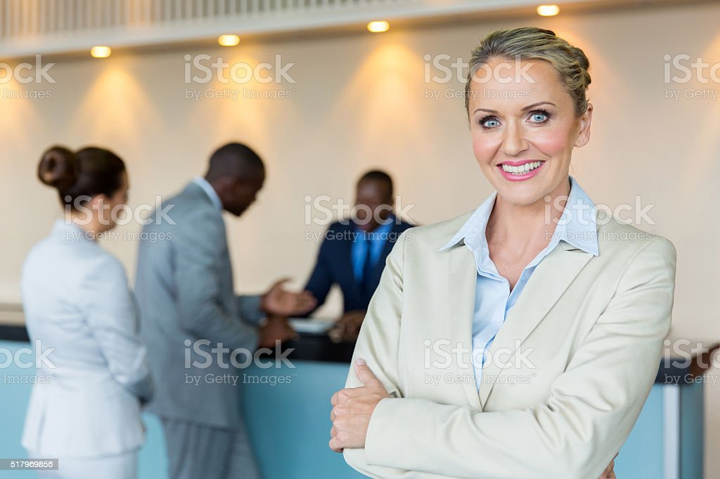 bank manager with customers on background stock photo