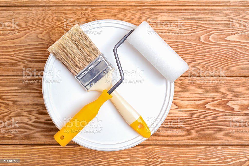 Bank of paint, paint brush and paint roller stock photo