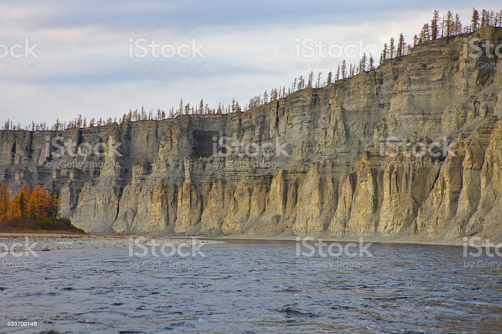 Bank of the river  Moierokan and Siberian taiga in the autumn stock photo