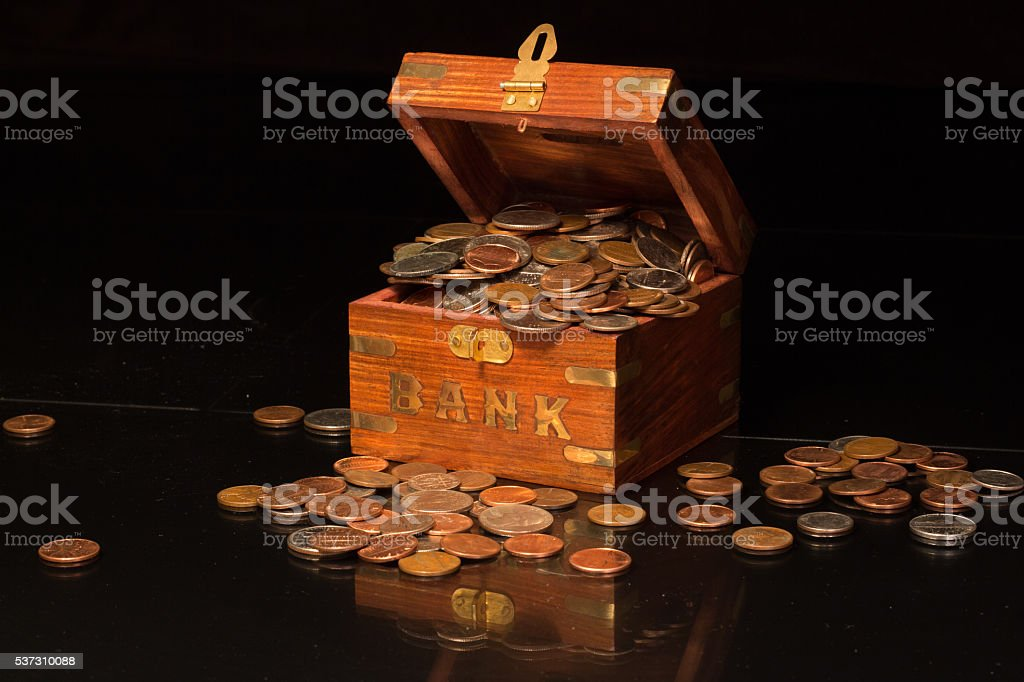 Bank Overflowing With Change stock photo