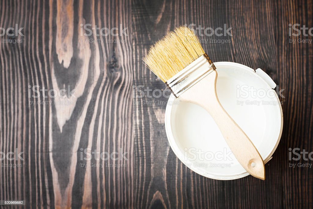 Bank paints and brush on a wooden background stock photo