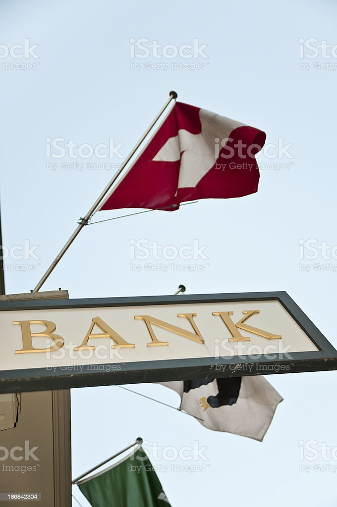 bank sign and swiss flag stock photo