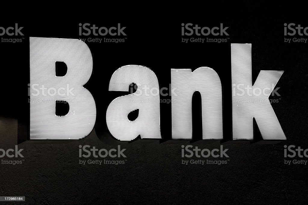 bank sign illuminated at night royalty-free stock photo