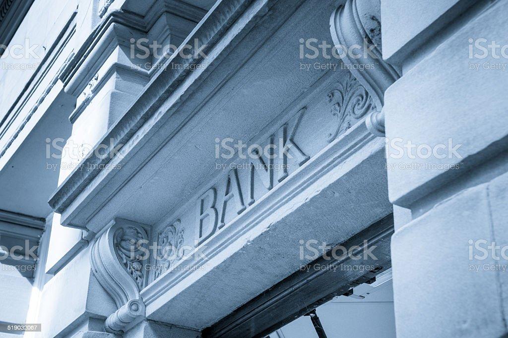 Bank Sign logo entrance, Stone Background stock photo