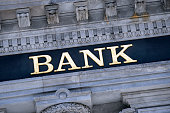Bank sign on a building exterior.