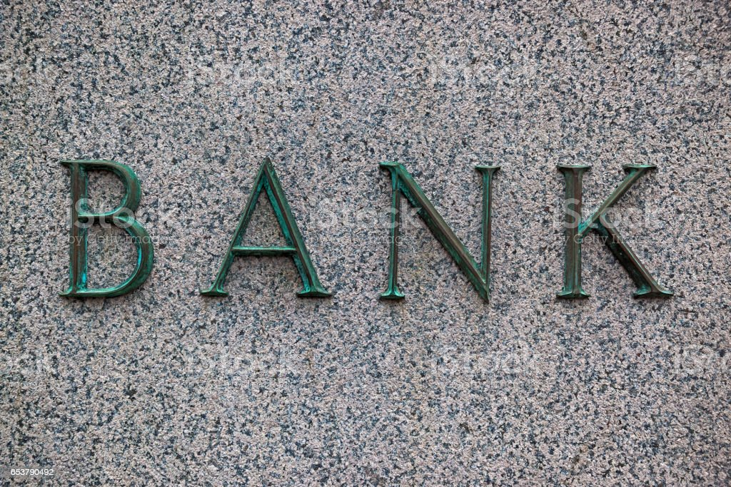 bank sign on the granite wall stock photo