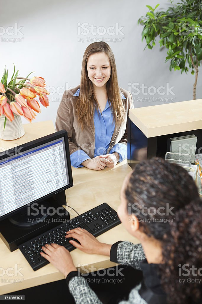 Bank Teller Providing Customer Service At Financial Banking Business Counter royalty-free stock photo