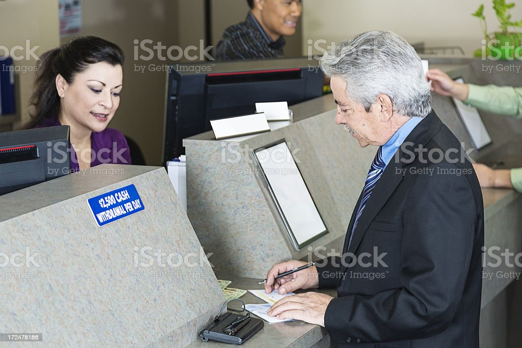 Bank Teller With Customer stock photo