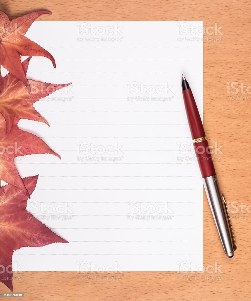 Bank white paper and pen on wooden table. stock photo