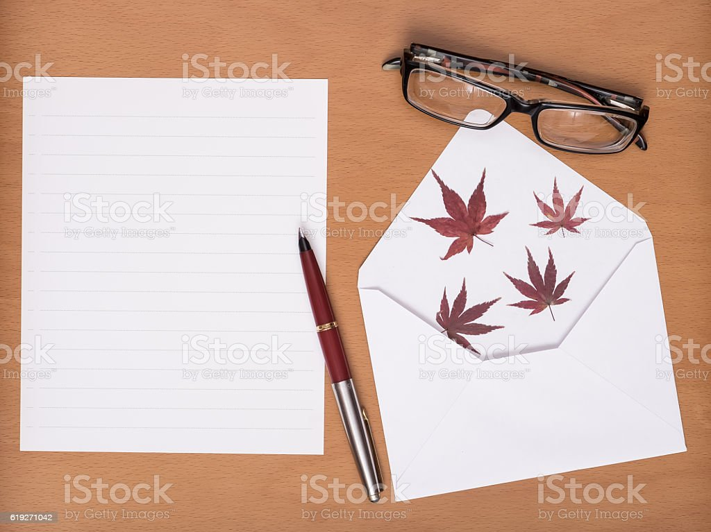Bank white paper, pen, glasses and envelope on wooden table. stock photo