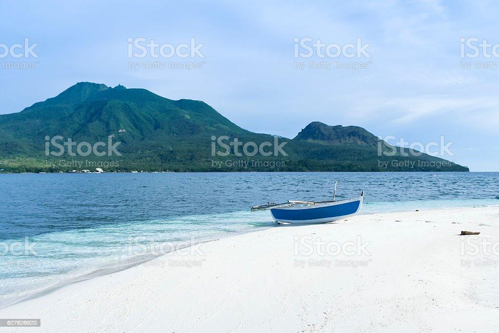 banka on white beach camiguin island stock photo