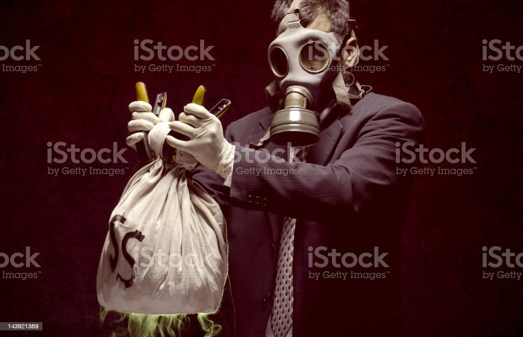 Banker holding toxic assets stock photo