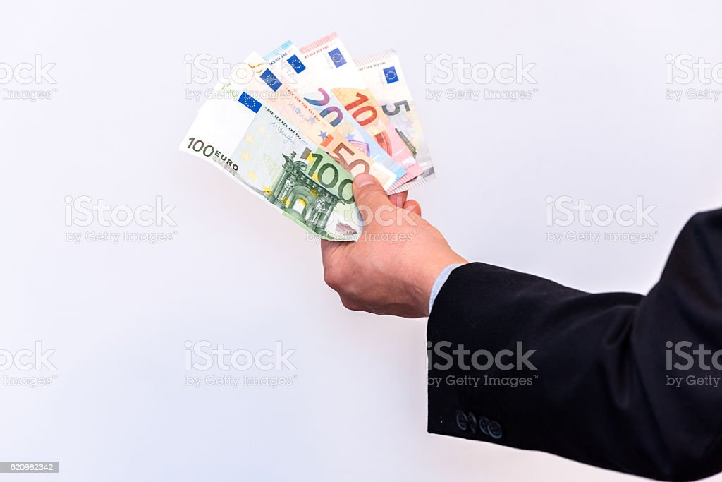 Banker holds Euro banknote cash in his hands stock photo