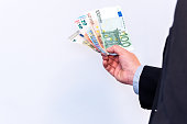 Banker holds Euro banknote cash in his hands