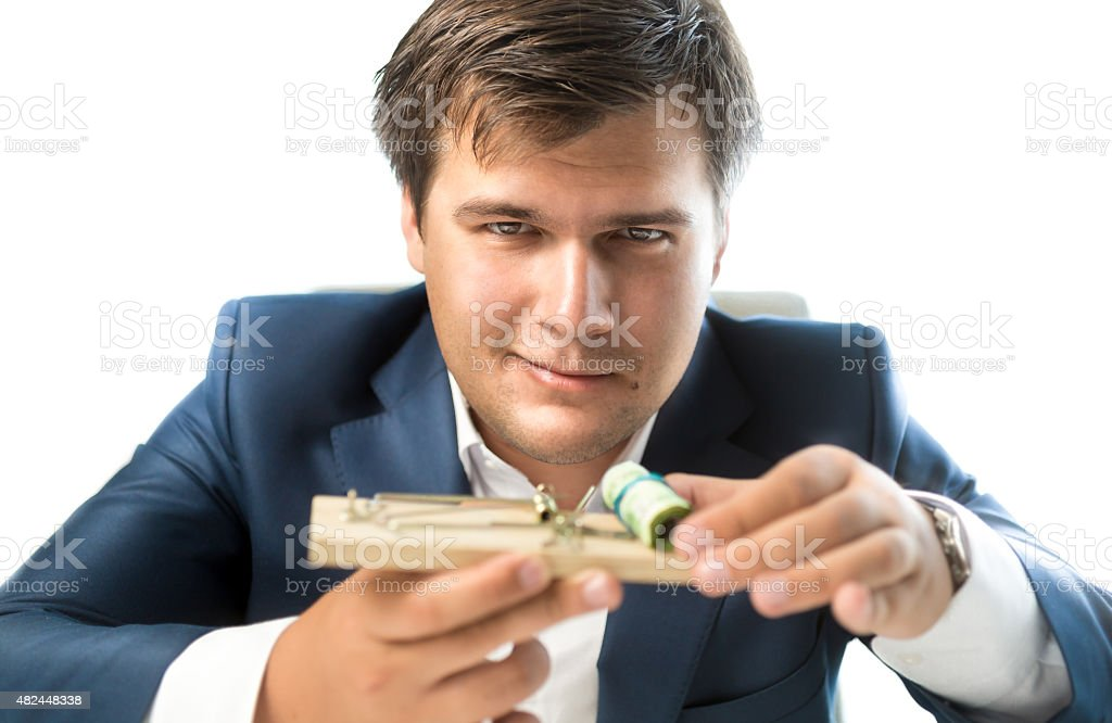 banker offering risky investment. Man holding mousetrap with mon stock photo