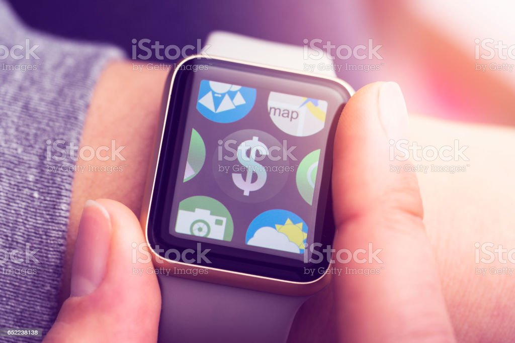 Banking application on smart watch touchscreen stock photo