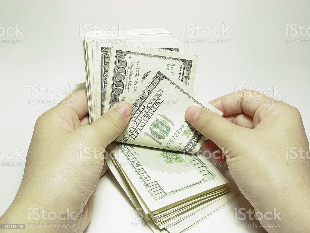 Banking / Counting $100 bills royalty-free stock photo