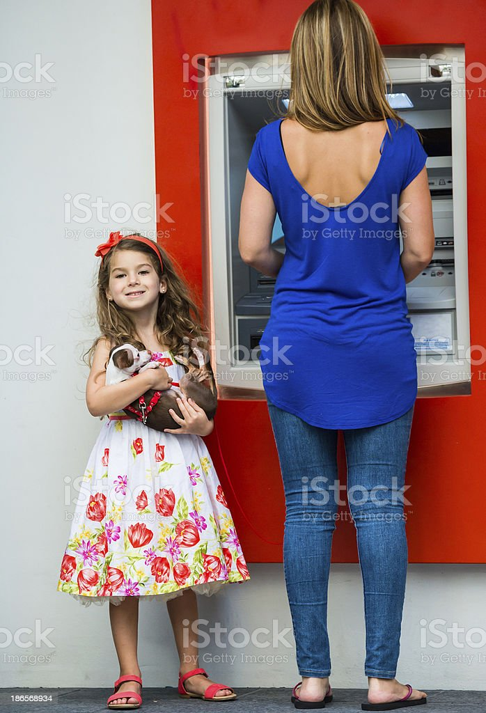 Banking with mom royalty-free stock photo