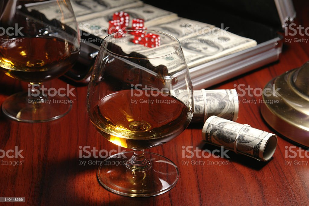 banknote and glass of cognac royalty-free stock photo