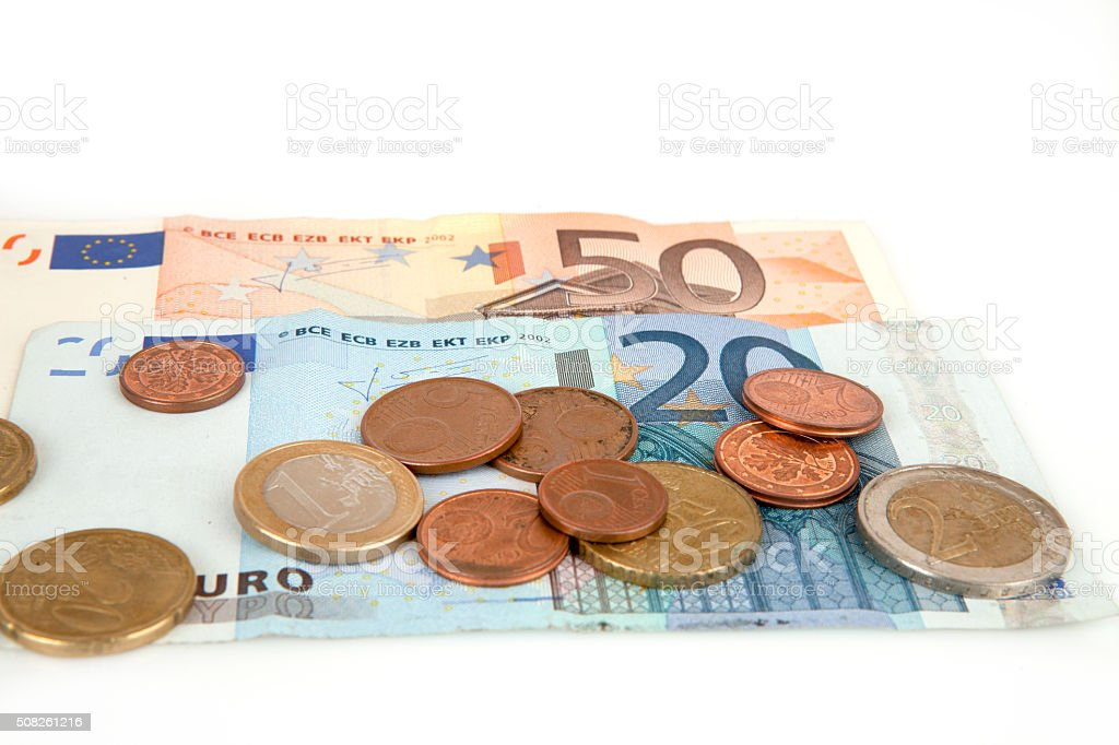 Banknotes and coins euro isolated on the white background stock photo