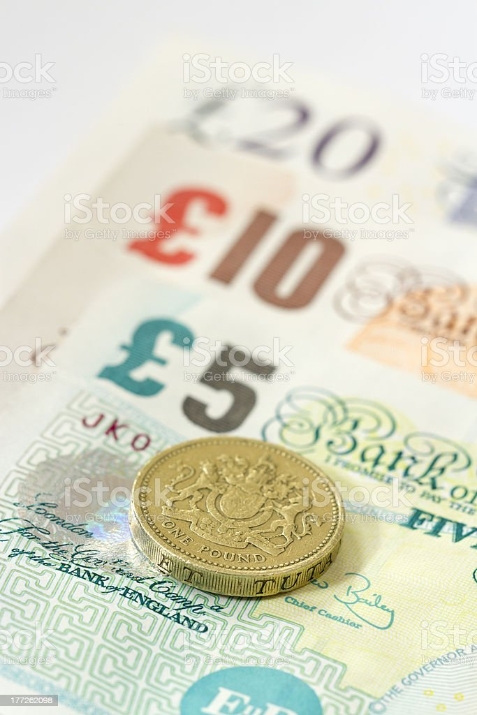 UK Banknotes And One Pound Coin royalty-free stock photo