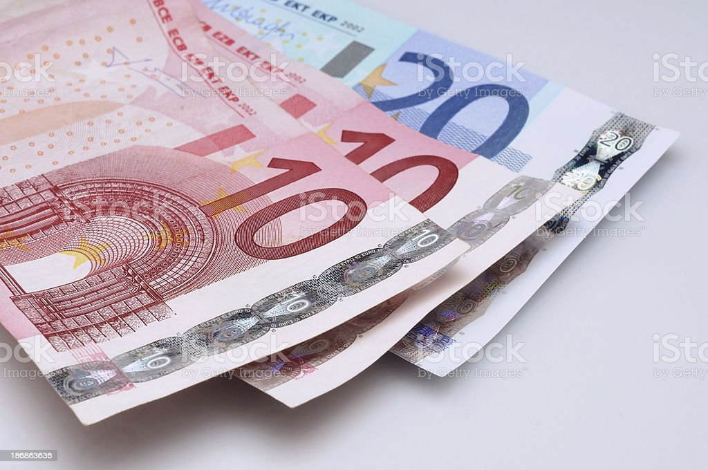 Banknotes arranged in a fan-shaped royalty-free stock photo