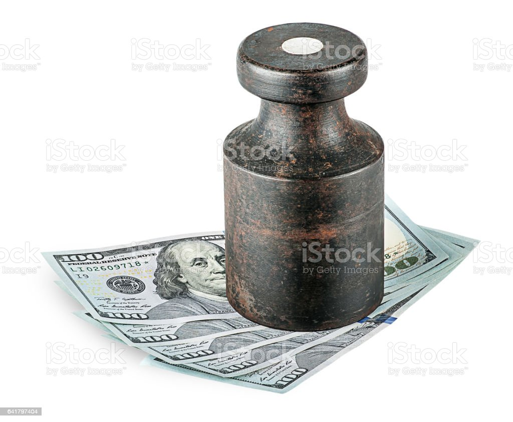 Banknotes clamped old rusty weights stock photo