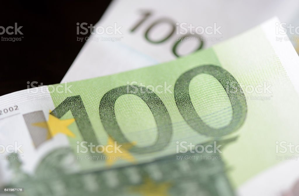 Banknotes in one hundred euros closeup stock photo