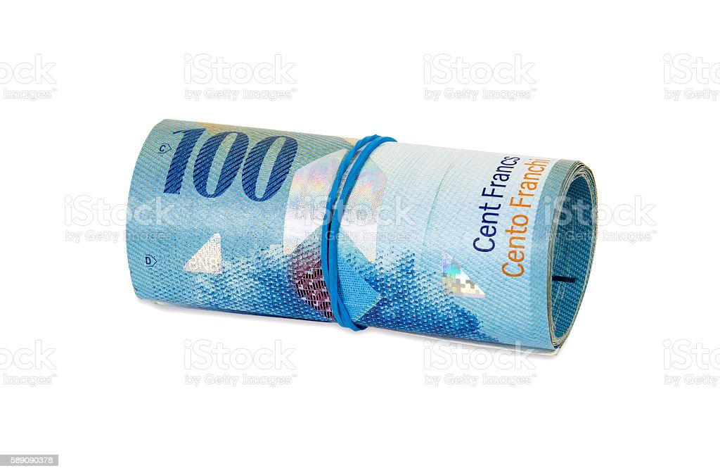 Banknotes of 100 swiss franc rolled with rubber stock photo