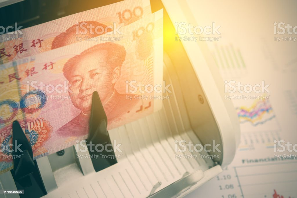 Banknotes of China with a portrait of Mao Zedong. stock photo