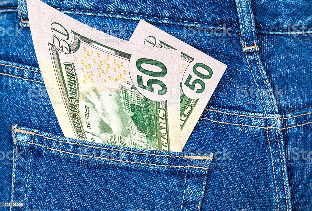 Banknotes of fifty dollars bill sticking out of the pocket stock photo