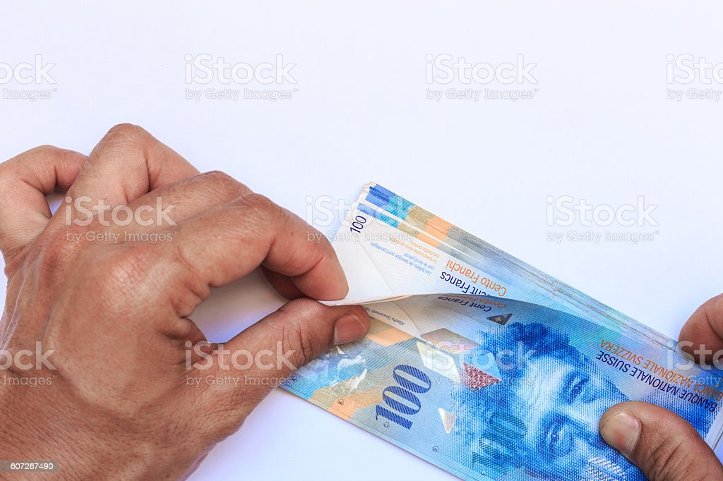Banknotes of swiss currency on hand white background stock photo