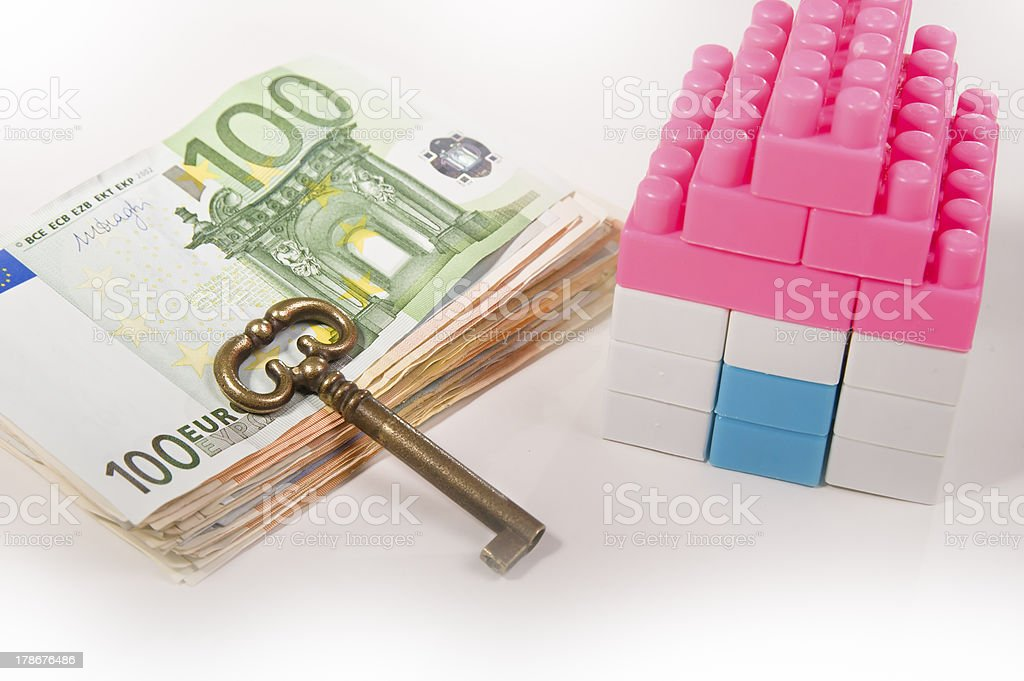 Banknotes path Miniature House with Key royalty-free stock photo