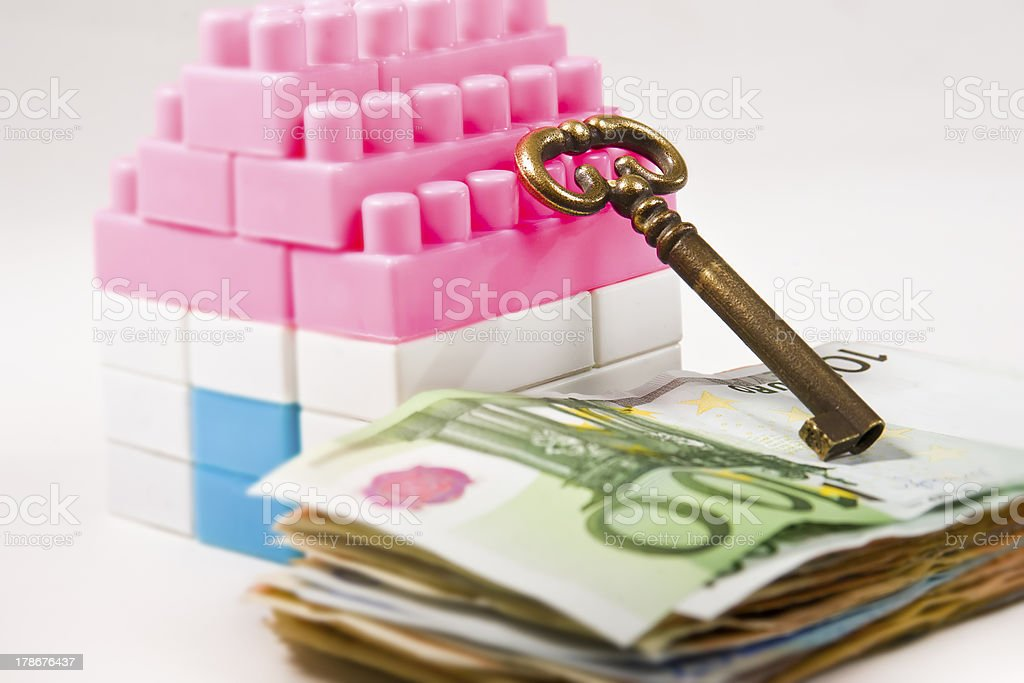 Banknotes pile,Miniature House and Key royalty-free stock photo