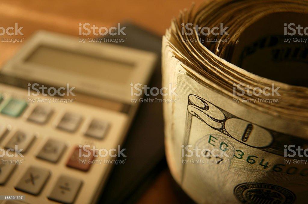 Bankroll and Calculator royalty-free stock photo