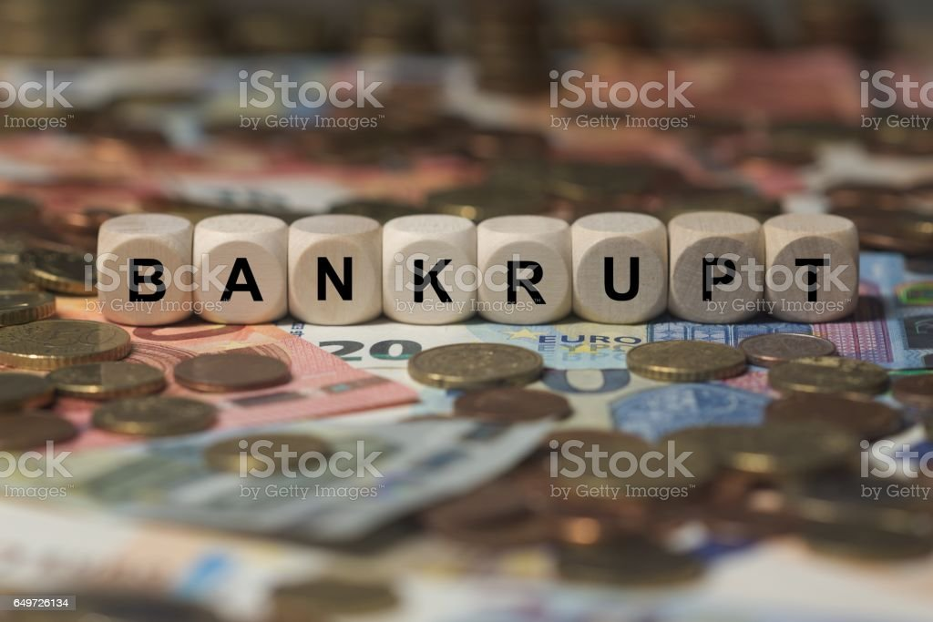bankrupt - cube with letters, money sector terms - sign with wooden cubes stock photo