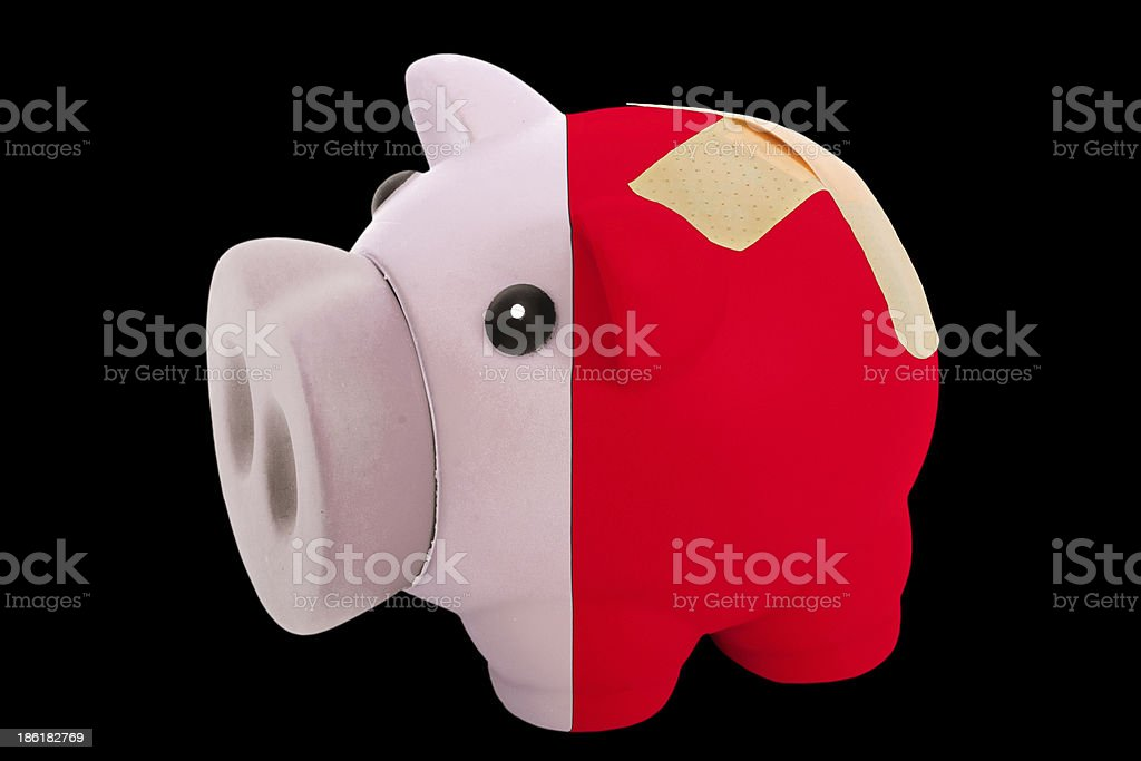 bankrupt piggy rich bank in colors of malta royalty-free stock photo