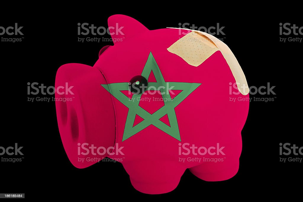 bankrupt piggy rich bank in colors of morocco royalty-free stock photo