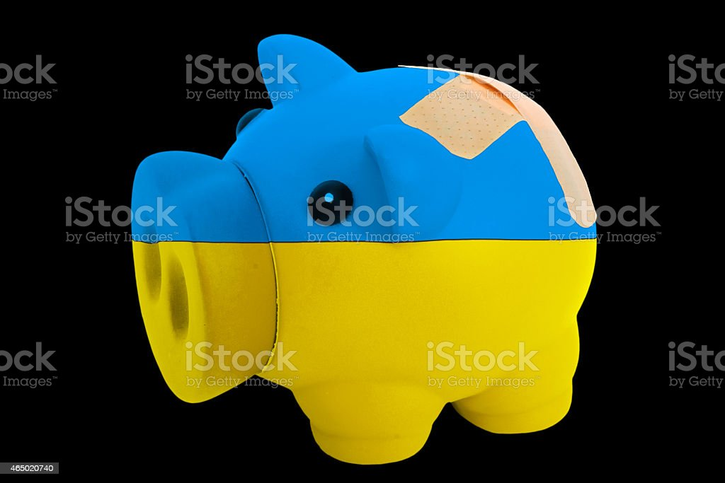 bankrupt piggy rich coin bank in colors of ukraine stock photo