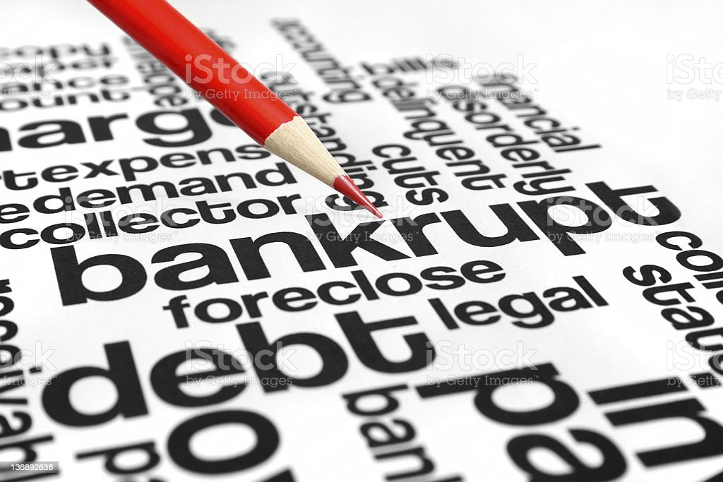 Bankruptcy graphic with words in black text and a red pencil stock photo