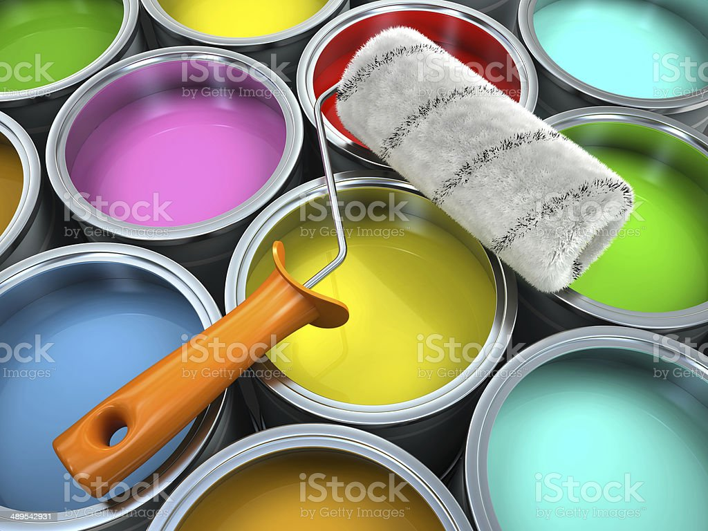Banks of multicolored paint and roll stock photo