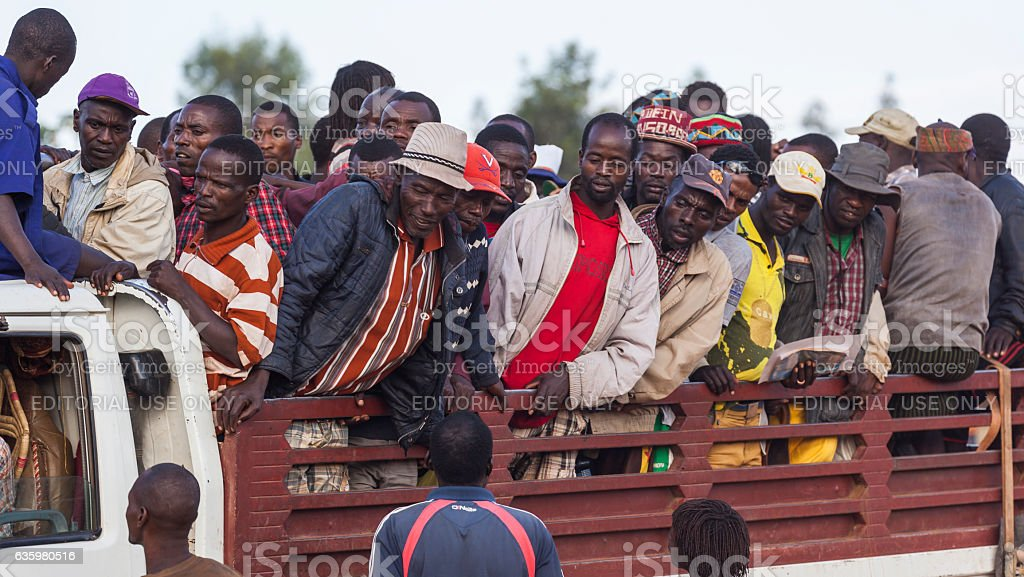 Banna man at back of a truck. Omo Valley. Ethiopia stock photo