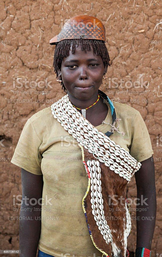 Banna woman in calabash hat/helmet at village market. Key Afar.Ethiopia. stock photo